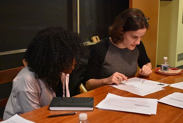 Freshman Gabriela Santana, left, looks over her resume with alumna Thea Chimento (A10)