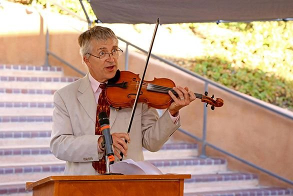 Tutor Cary Stickney plays the fiddle