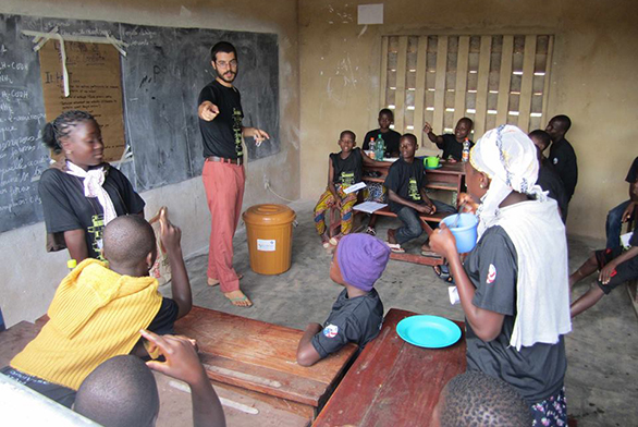 Chazaq Llinas helps prepare students for the national spelling bee in Benin in 2015.