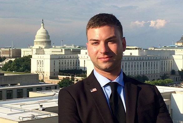 Tyler Mazur (A20) poses for a photo in front of the U.S. Capitol.