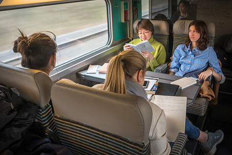 Study abroad students on a train to Paris.