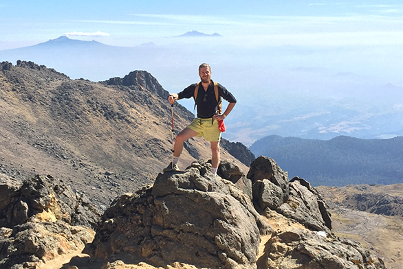 Tristan Janes stands on the side of Iztaccihuatl in Mexico.