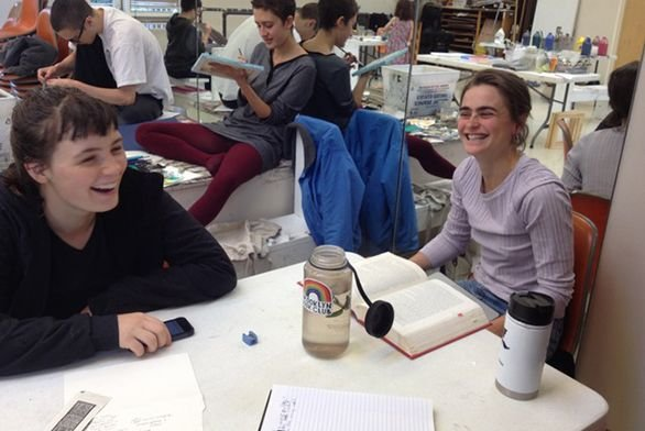 Students laughing in art room