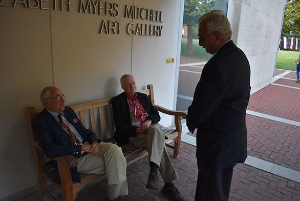 Allan Hoffman, left, Steve Benedict and Nick Maistrellis converse outside of The Mitchell Gallery.