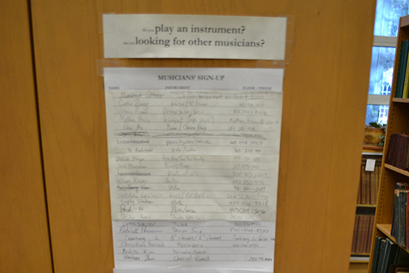 A sign-up sheet hangs in the music library.