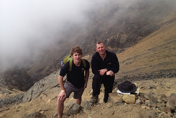 Tristan Janes (left) and his father, Jason Janes, stand on the volcano as they tried to summit it several years ago.