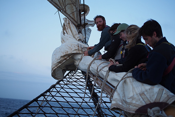Mary Christman (second from top) works hard during the trans-Atlantic voyage.