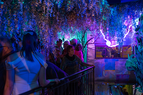 Members of the public visit a Meow Wolf exhibit.