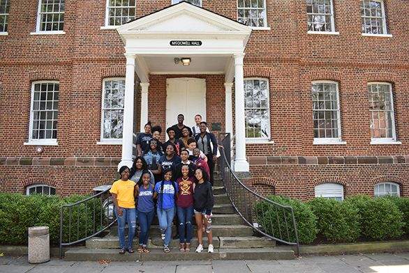 Students in UNCF program on steps of McDowell Hall