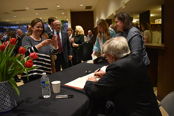 Brokaw signs autographs after the event.