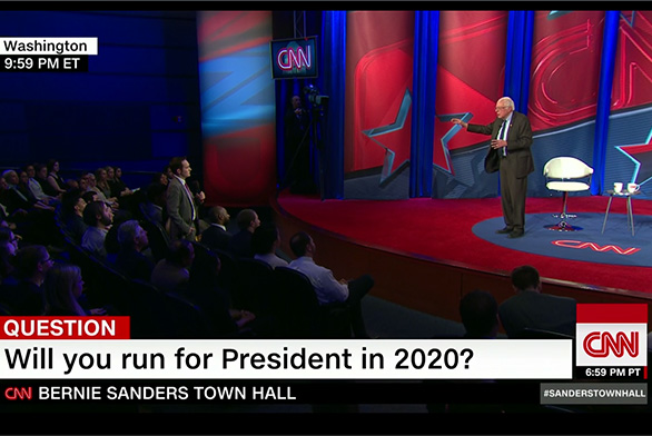Neale listens as Sanders addresses his question at the CNN Town Hall.