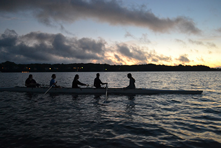 The St. John's Crew team rows in the Severn River before sunrise.