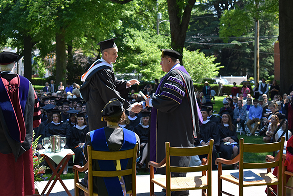 More than 100 St. John's graduates shook the hand of outgoing President Chris Nelson at Commencement on May 14.