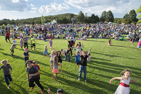 A crowd assembles on the lawn during a Music on the Hill concert in Santa Fe