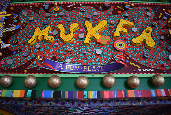 "A gate welcomes visitors to Mukfa, ""A Fun Place"""