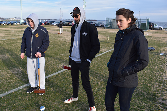 Members of the Naval Academy and St. John's croquet teams hang out at the Academy during a friendly match.