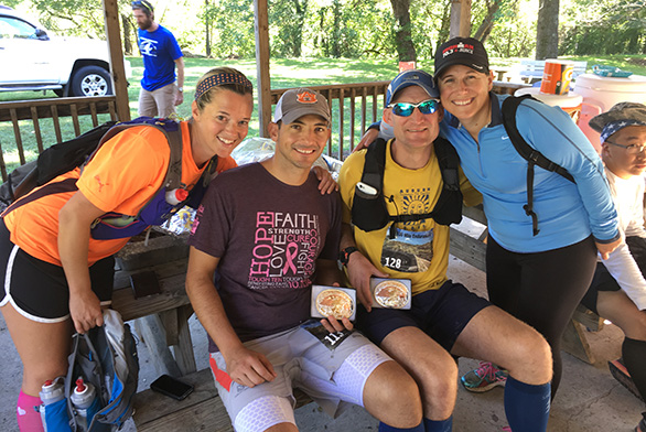 Summer and Gary Vaughn sit with Carter (second from right) and Carter's wife, Nicole, at an ultra-marathon.