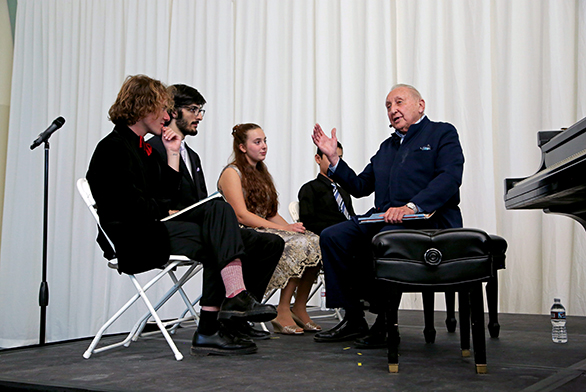 St. John's students Evan Quarles and Jack Mooradian (left) work with Seymour Bernstein (right) during a master class in Santa Fe.