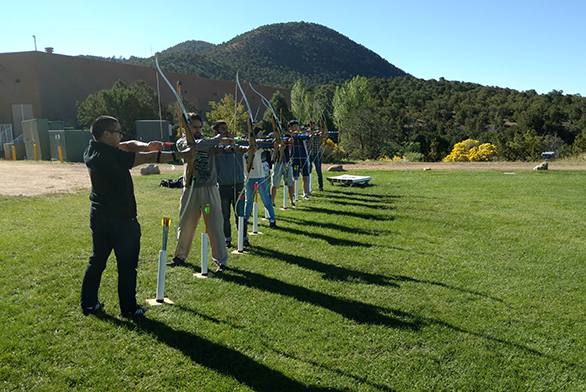 Members of the Archery Club line up in Santa Fe.