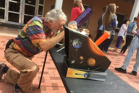 Tutor emeritus Bill Donahue sets up two telescopes, including a projection telescope, in preparation for the solar eclipse in Santa Fe.