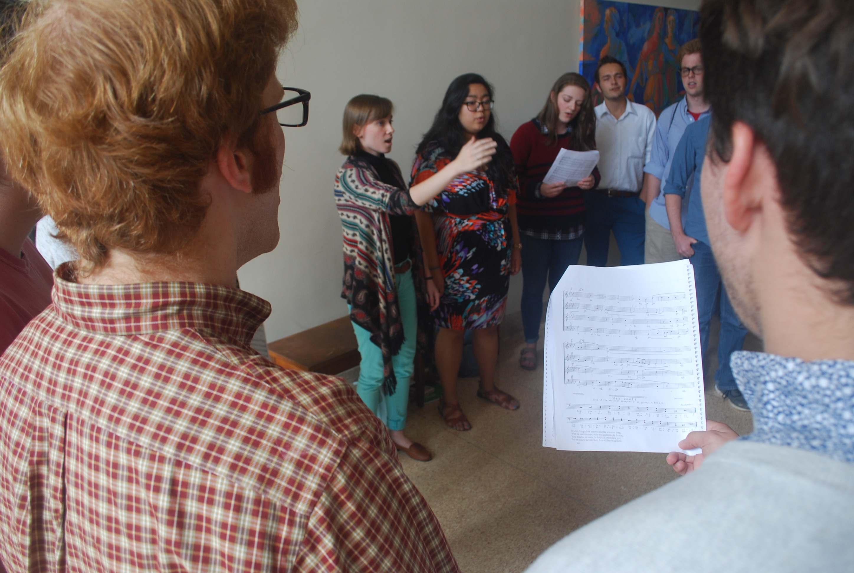 Maura Sugg leads St. John's students in the singing of Sicut Cervus