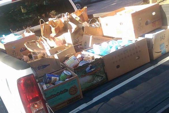 A truck full of canned goods awaits delivery to the Light House shelter.
