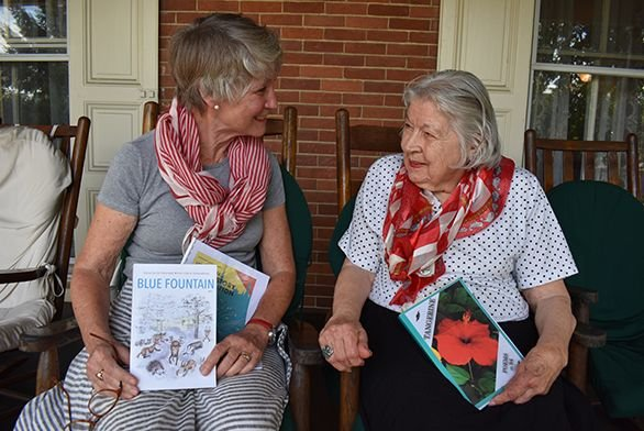 Constance Lindgreen and Mary Jean Bell hold their books