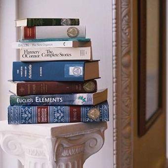 Stack of St Johns College Program Books